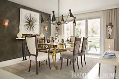 A gorgeous gray wallcovering, alluring dining table, and striking light fixture combine to create a glamorous dining room. - Photo: Karyn Millet / Design: Nancy Price