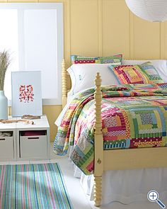 patchwork, stripey rug, yummy colours...Ohh goodness sakes alive. Yellow walls. Teal stripes on the floor. colors on the bed. Heaven must look like this!