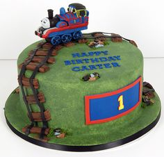 thomas cake- so cute!! Love the track idea. Maybe do this for Alec's birthday with a sheet cake and a real train.