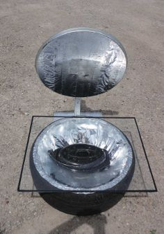 Providence Acres: Our DIY Solar Oven Out of an old car Tire.  lots of pictures and DIY video.  (plywood base, cardboard insulation, foil lining, glass cover, old satellite dish reflector)