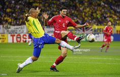 Ronaldo of Brazil tries to tackle Alpay Ozalan of Turkey during the FIFA World Cup Finals 2002 Semi-Final match played at the Saitama Stadium, in Saitama-Ken, Japan on June 26, 2002. Brazil won the match 1-0. DIGITAL