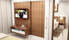 detalhe: a porta do banheiro de correr por fora se esconde no painel da tv