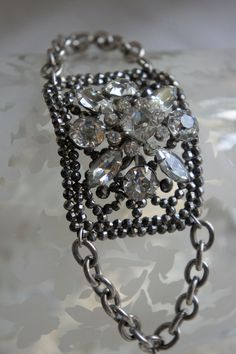 Vintage assemblage french cuff bracelet with rhinestones assemblage jewelry - Night On The Town by French Feather Designs.  via Etsy.
