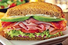 Submitted to our Facebook wall by one of our fans.     This sandwich includes: Avocados, sliced ham, swiss cheese, bacon, lettuce, red onions on wheat bread, with mayo or ranch dressing.
