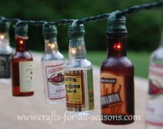 Hang mini alcohol bottles with floral tape to a string of xmas lights