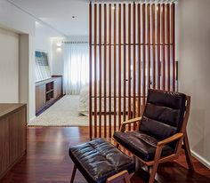 Home & Apartment, Amazing Ligneous Chair With Foot Rest And Brown Leather Covered Looks Elegant In This Room Also Wooden Room Divider Embellish Design: Astonishing Urban Living Space Design: Open House Small Room Divider, Sliding Room Dividers, Timber Slats, Wooden Room, Tiny Apartments, White Ceiling, Screen Design, Home Bedroom, Master Bedrooms