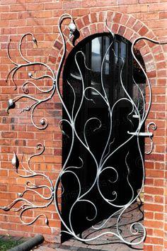 G26: Playful Metal Garden Gate