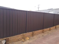 Colorbond fencing with wooden retaining wall, to account for the soil height variation. Wooden Retaining Wall, Portable Fence, Metal Fence Panels, Outdoor Rooms, Outdoor Decor, Fencing Material, Perth, Steel, Garden