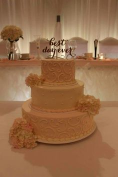 3-tier wedding cake - top and bottom tiers are pale pink with white scrolls. www.mitchels.ca #wedding #weddingcakes #3tier #pink