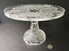 "Greentown Indiana Tumbler and Goblet Co. Early American # 200 Austrian or Finecut Medallion pattern glass pedestal footed Cakestand in Crystal.  It has a dimpled Rum Well in the center. 10 1/8""D x 6 9/16""H, 5"" base"