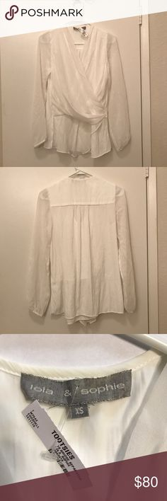 Long Sleeve Top This is a long white sleeved top. It is sheer throughout the sleeves and hangs loose throughout the top. Nice for an interview or dinner. Never been worn. lola and sophie Tops Blouses