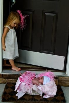 New baby picture with big sibling. Cute idea, but I'd wonder if the elder would shut the door and tell Mom that it was someone armed and dangerous at the door. LOL