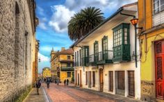 A street in downtown Bogota in the La Candelaria neighborhood. This is calle just west of Carrera A block down the street is the Plaza de Bolivar. Wonderful Places, Beautiful Places, Colombian Cities, Hotel Boutique, Colombia Travel, All Inclusive Vacations, South America, Places To See, Quebec