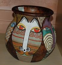 Inspired by the artwork of Laurel Burch.  Handmade by  women from Kenya's Luo tribe and then hand painted by a Nairobi artist. Approximately 8 - 8.5 inches tall and 8 inches. #pottery #africa