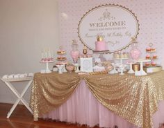 Great sparkly gold tablecloth with pink tutu, lovely <3