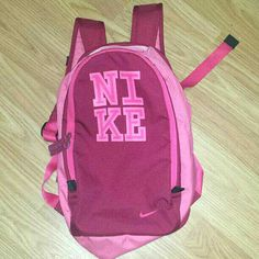 Brand: NIKE  EUC Pink & Red medium size backpack  A Great accessory to take to the gym, dance class, an over night, a bike ride or what ever you choose to use it for? *This kind of matches the Pumas I posted earlier...See my other items to!