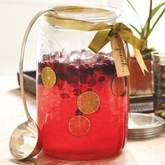Holiday Punch Jar w/ Ladle-Love the Label tied w/ a Bow, So Festive!   ~Holiday Punch~ recipe courtesy of Sandra Lee~Ingredients: Mix 1 (46 oz)  red Hawaiian punch, 1 (46 oz) apple juice, 1 (48 oz) cranberry juice, 1 (2 liter) bottle ginger ale, add ice cubes & stir. Garnish w/ cranberries, orange & lime slices. Berry vodka & Orange liqueur, optional