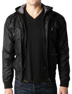 Sizes may run small; please choose a size up. Moto styling defines a slim jacket crafted from supple faux leather, designed with a removable jersey hooded for a cool layered look. Sleek, versatile and