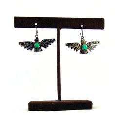 Thunderbird earrings featuring turquoise detail