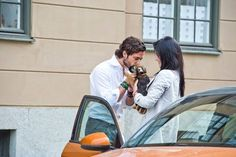 Prince Carl Philip and Sofia Hellqvist at the courtyard of the Royal Palace on Friday, with their dog Siri.
