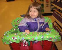 Sophie in her cart-covered seat