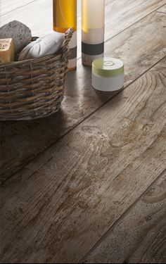 Tile that looks like wood!    Photo features Season Wood™ Orchard Grey 12 x 48, 8 x 48, and 4 x 48 field tile in a staggered pattern on the floor