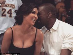 Feeling nostalgic? Pregnant Kim Kardashian showed off her cleavage in a series of revealing throwback Thursday pictures taken at a Lakers game with Kanye West