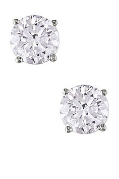 Round Diamond Stud Earrings.  The definition of classic.  Buy with screw-on backs to reduce fear of loss.  Wear with EVERYTHING.  (chicfoo)