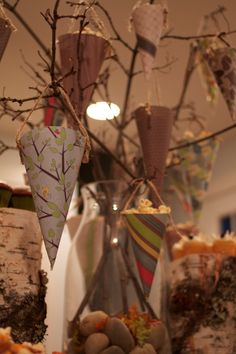 Paper cones with popcorn and treats, strung from branches!!