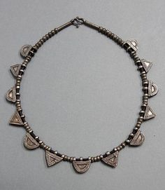 Contemporary necklace made with old silver alloy telsum amulets from the Oromo people of Ethiopia. Combined with old silver beads