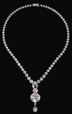 IMPORTANT LIGHT PINK DIAMOND AND DIAMOND NECKLACE. Suspending a detachable pendant set with two marquise diamonds, a brilliant-cut light pink diamond weighing 6.93 carats, two circular-cut diamonds, one weighing 34.78 carats, and a briolette diamond weighing 11.38 carats, from a graduated circular-cut diamond rivière with a step-cut diamond clasp, length approximately 555mm.