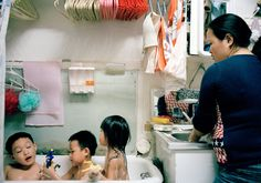 """Intrigued by how they lived in a compact apartment in Chinatown in 2003, Thomas Holton began documenting a family that would later grow apart. His works will be published in a book titled """"The Lams of Ludlow Street."""""""