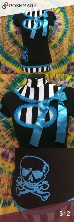 Rockabilly punk top blue black and skulls Super cute black and blue top with peek a boo in the front, a bow and a skull on the right hip. It has lace details at the bottom of the shirt, collar and at the end of the capped sleeves. Size medium, from hot topic. Hot Topic Tops Blouses