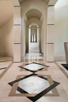 marble flooring This grand hallway features all-over neutral marble, towering arches and an eye-catching geometric floor design. A shelf at the end of the hallway provides a place for displaying decorative vases. Floor Design, Ceiling Design, Tile Design, House Design, Marble Design Floor, Granite Flooring, Lobby Design, Floor Patterns, Marble Floor