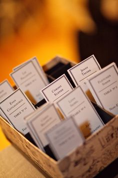 Emily and Phil's book-loving wedding had a pretty sweet book tie-in: bookmark escort cards! Take your card, find your seat, and have a little keepsake to remind you of a kick-ass wedding while you'...