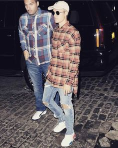 Justin Bieber Wearing A Snoopy Cap, Fear of God Shirt, Pants And Adidas NMD