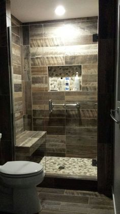 Wood plank tiled shower shower seat idea pebble floors and wood title lighter color; master bath