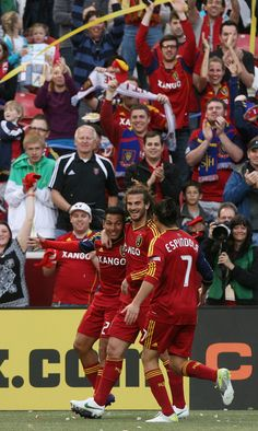 RSL's Paulo Junior, left, is mobbed by teammates Kyle Beckerman and Fabian Espindola after making a penalty kick