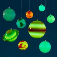 Let the planets guide them. | 35 Out-Of-This-World Ideas For A Space-Themed Nursery