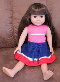 Adorable hand knitted doll Skirt made out of Red Heart Yarn  Skirt has a crochet drawstring so skirt can easily be put on and off and is 5 inches long  Fits 18 inch Dolls, Waldorf Dolls and American Girl Dolls  Made in a smoke free home  Doll and other clothes are not included