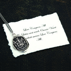 """Love Conquers All"" Talisman, with meaning card.  Such a card accompanies every Pyrrha talisman."
