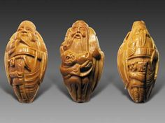 These look like they could be nesuke.  Peach is associated with escape, in Chinese culture, so peach pit carvings are widely used as pendants or on as a string of beads to ward of evil and avoid misfortunes.