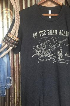 "The Vaquero - ""On the road again, pack lighter go further"" graphic tee. Rustic white graphics with desert and cactus landscape with donkey and vaquero. Soft charcoal gray t-shirt. Cowgirl style. Rodeo fashion. Women's Western Wear. Ranch style. Boho Cowgirl."