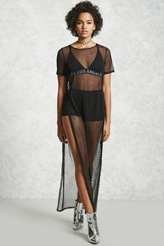 A maxi dress featuring a sheer, netted mesh construction, a round neck, short sleeves, and exaggerated side slits.