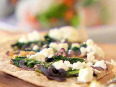Arugula, Caramelized Onion and Goat Cheese Pizza recipe from Ellie Krieger via Food Network