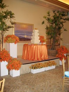 Beautiful wedding reception at the Resort at Pelican Hill Newport Beach, CA. The boxes were filled with roses, orchids and protea and brought in from the ceremony area. Linens provided by Fusion Linens and Coordination by Laurie Davies of Five Star Weddings and  Events.