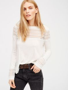 Irresistibly soft long sleeve tee with sheer mesh panels along the front and back and on the sleeve cuffs. Subtle smocked detail in back.