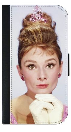 Vintage British Actress Audrey Hepburn in Black and White Apple iPhone 7 Universal (Not Compatible with the iPhone 7 Plus) PU Leather Wallet Case with Flip Cover and Magnetic Clasp. Quality Leather-Look Wallet Case with Flip Cover and Magnetic Clasp Compatible with the Standard Apple iPhone 7 Universal (Not Compatible with the Apple iPhone 7 Plus). Bright, Eye-Catching Flat-Printed Image on Metal Substrate with Glossy Finish. Made and Manufactured in the U.S.A. Excellent Customer Service!...