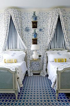 Sweet blue & white twin bedroom by Cathy Kincaid;  same canopy fabric and wallpaper create seamless backdrop