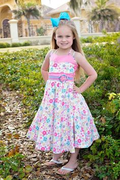 Savannah is our beautiful girls twirly pink floral spring and summer dress. The top has a pink band and two sets of straps, one set is for the shoulders and the second to tie in the back. The beautifu